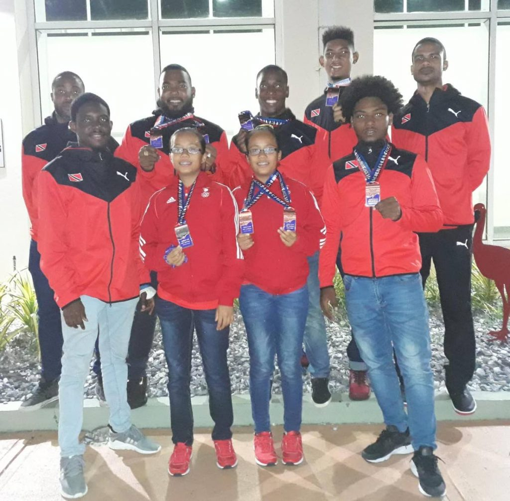 Members of the TT karate team pose with awards from the Caribbean Karate Championships in Dominican Republic. PHOTO PROVIDED BY SHIVA SOOKDEO