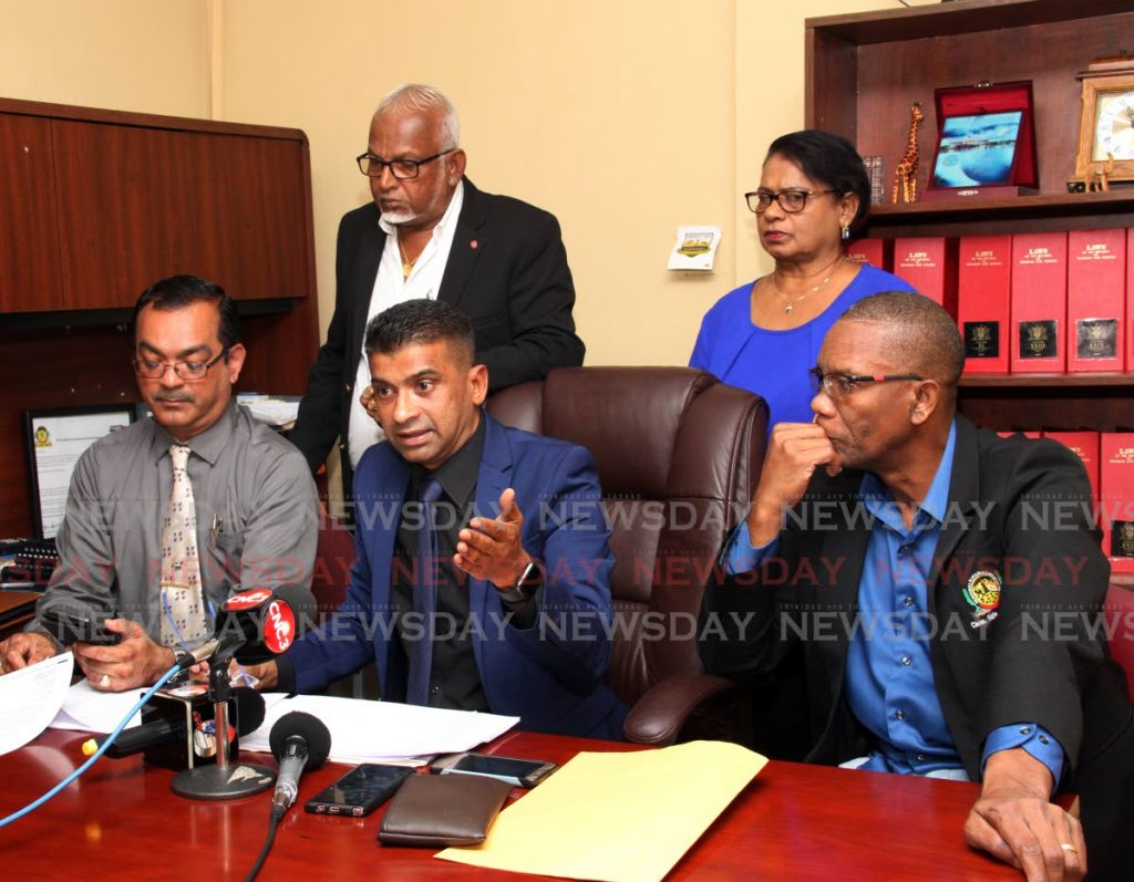 Chairman of the Siparia Regional Corporation Dr Glenn Ramadharsingh, centre, speaks at a press conference at his office on Monday. Others in photo are, from left,  UNC councillor for Cedros Shankar Teelucksingh, Doodnath Mayroo, Chanardaye Ramadharsingh and Deryck Colin Brown. PHOTO BY VASHTI SINGH