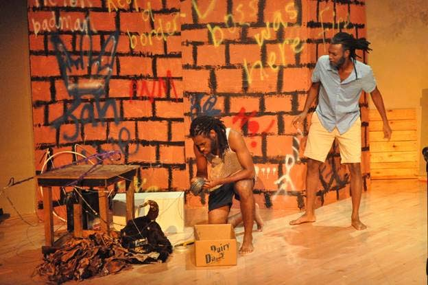Village elder, Eustace, right, looks at community youth Hainsley, left during a scene from Rayshawn Pierre's award-winning play 'Salt: No Seasoning' performed at the NAPA on Monday night.   PHOTO COURTESY THE MINISTRY OF COMMUNITY DEVELOPMENT, CULTURE AND THE ARTS