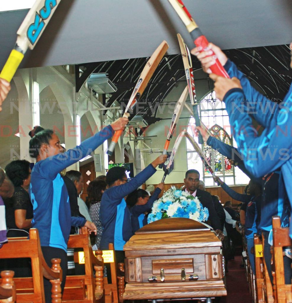 Cricketers from the K Rampath Cricket Academy, create a pathway for the late Burton Justin Dookhi during his funeral on Tuesday afternoon at Susamachar Presbyterian Church in San Fernando. PHOTO BY CHEQUANA WHEELER
