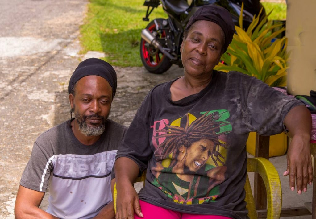 HAPPY TO BE ALIVE: Vaness Quashie Wright, right, and friend Brendon Ford lost their apartment building/family home to a fire at Bloody Bay on Tuesday. PHOTO BY DAVID REID