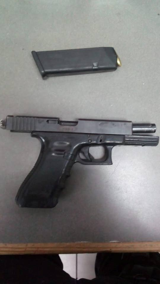 A Glock 17 pistol and 17 rounds of ammunition were found and confiscated during a police exercise along Duncan Street, Port of Spain on Wednesday night.   PHOTO COURTESY TTPS