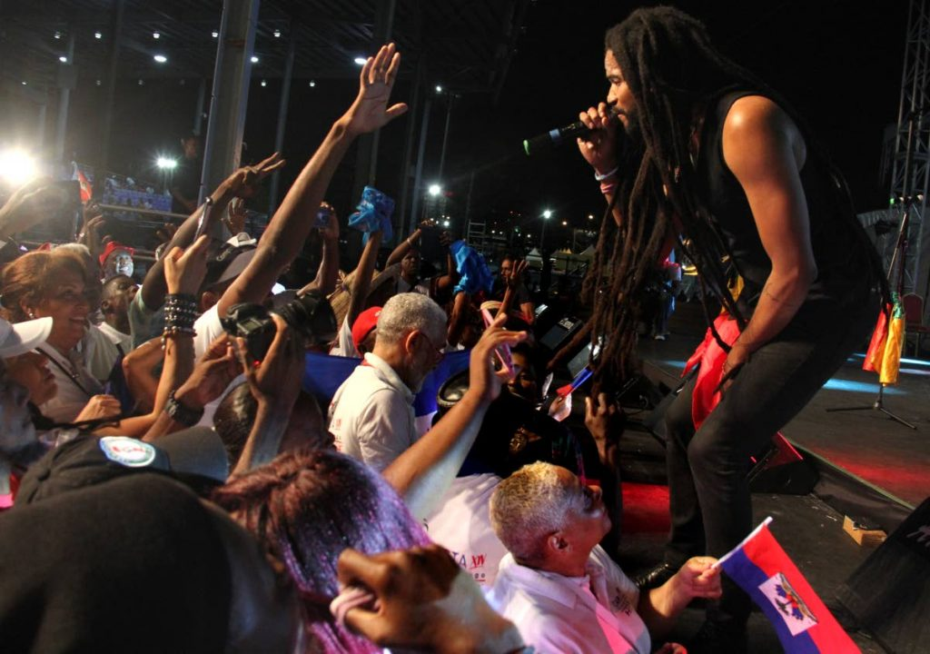 HAITI'S HEAT: Paul Beaubrun of Haiti had the audience eating out of his hands at the Carifesta Country Night at the Queen's park Savannah on Thursday.