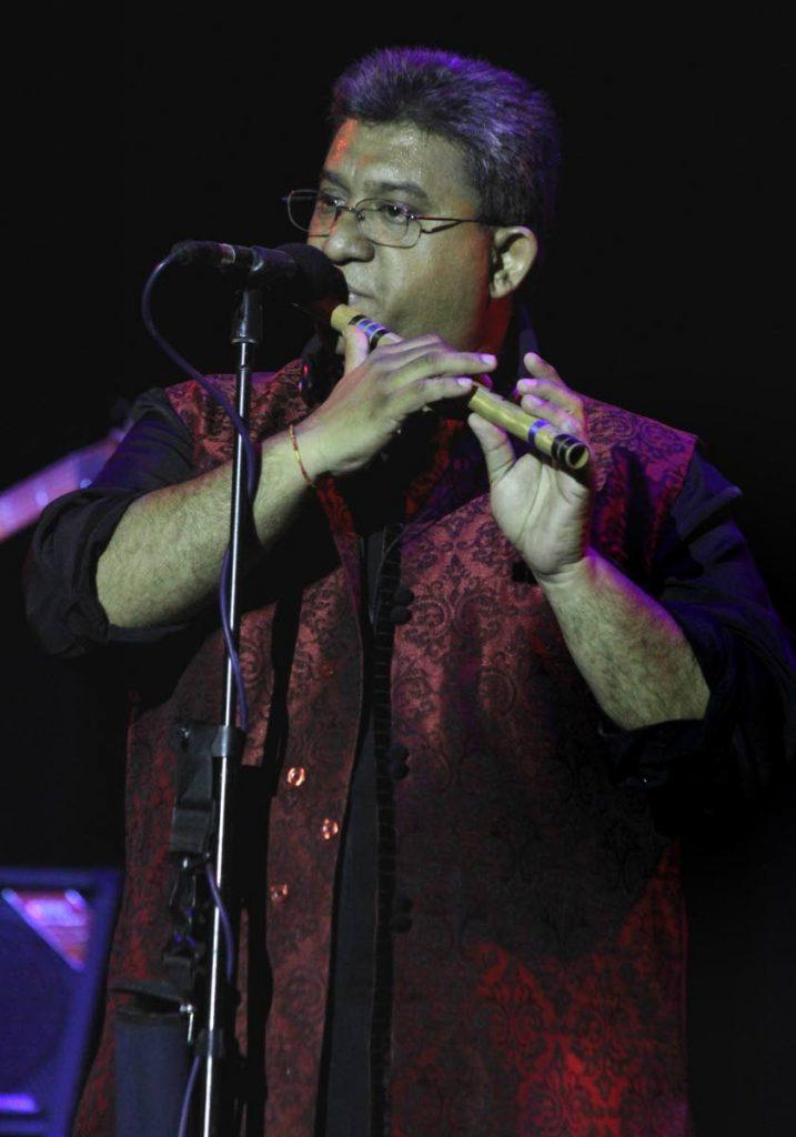 Narendra Maharaj entertains the audience at the Carifesta cultutal showcase Rangeela at the Central Bank Auditorium on Thursday night.