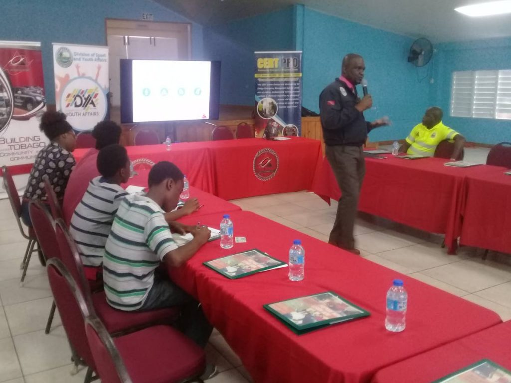 Director of the Tobago Emergency Management Agency Allan Stewart addresses participants at a disaster preparedness workshop at the Calder Hall Multi Purpose Facility on Monday. PHOTO BY COREY CONNELLY