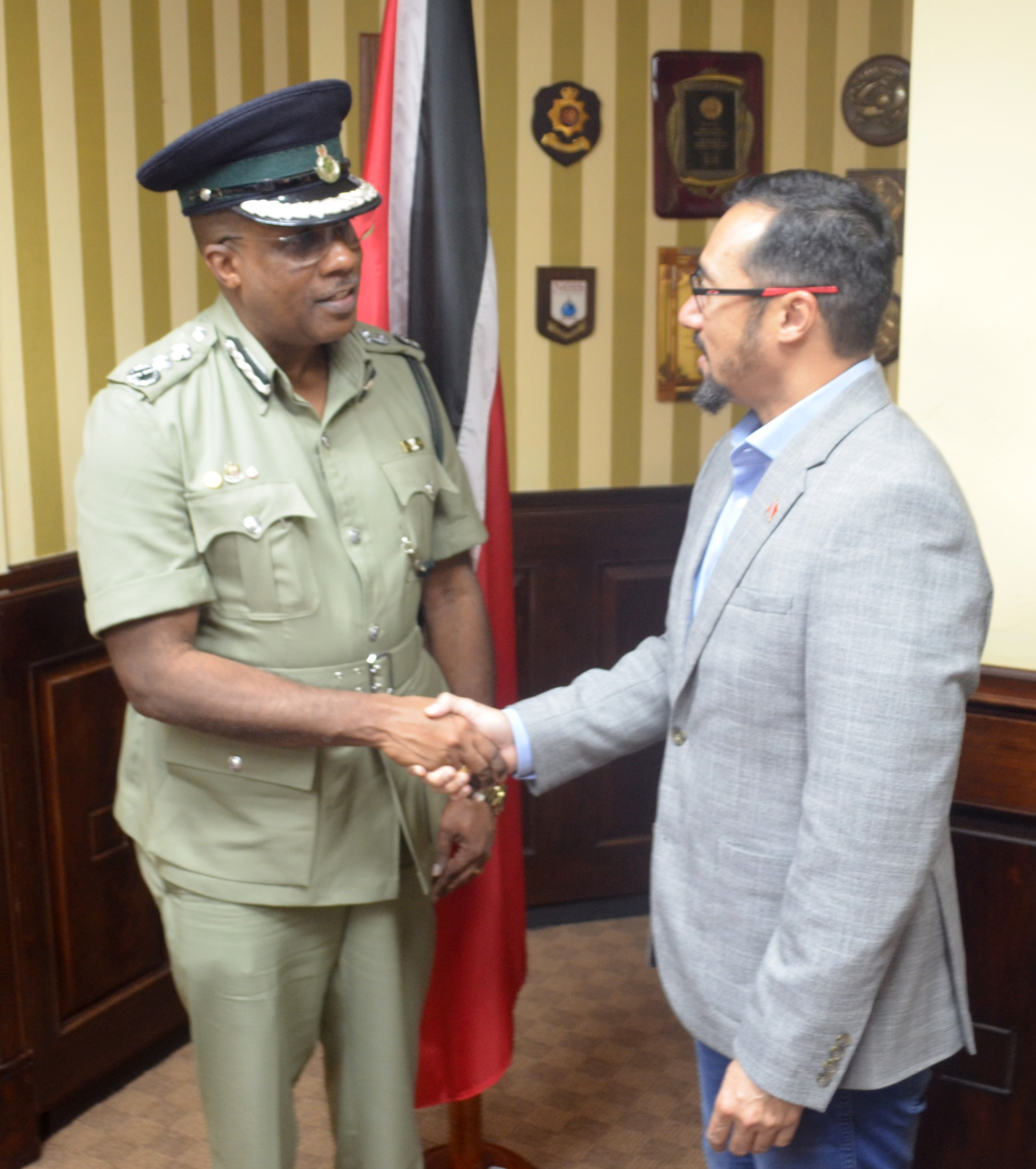 Minister of National Security the Honourable Stuart R. Young M.P. (right) congratulates Mr. Gerard Wilson (left) on his appointment as Commissioner of Prisons. Photo courtesy Ministry of National Security.