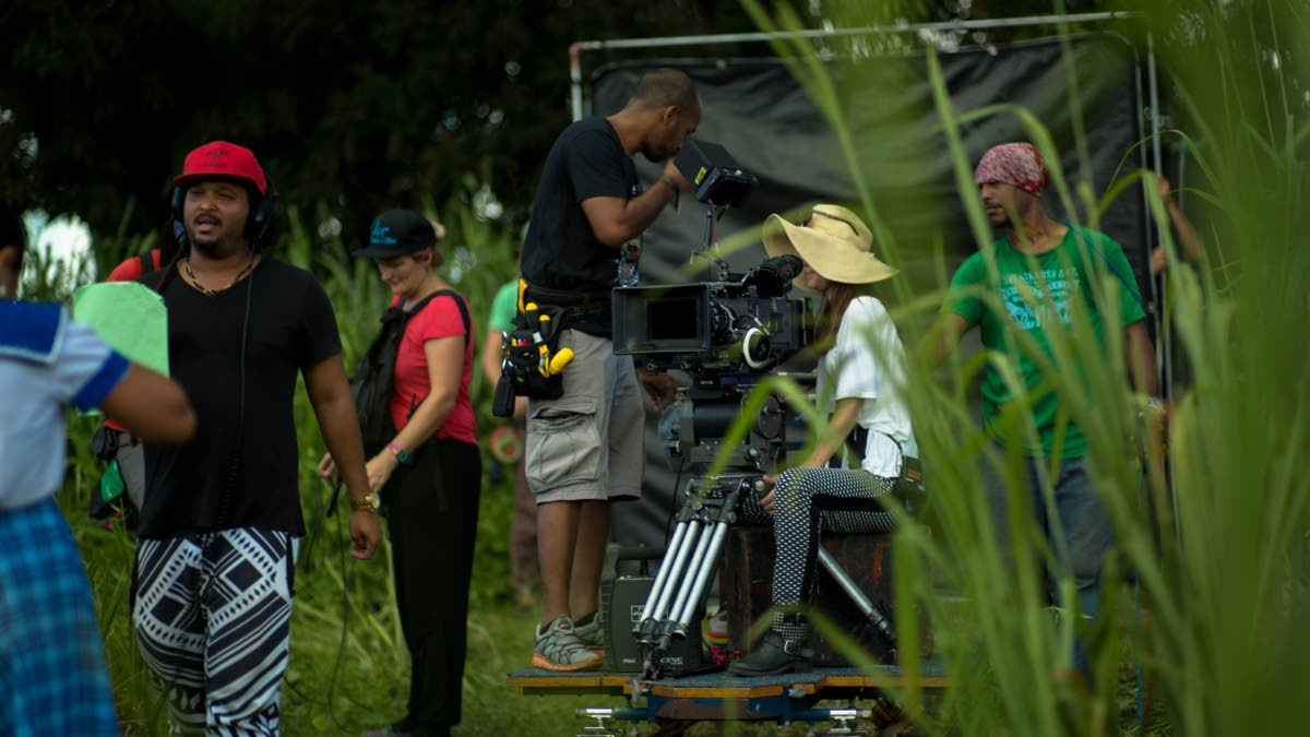 Making movies: Filmmaker Michael Mooleedhar, (left in red cap) on the set of Green Days by the River.