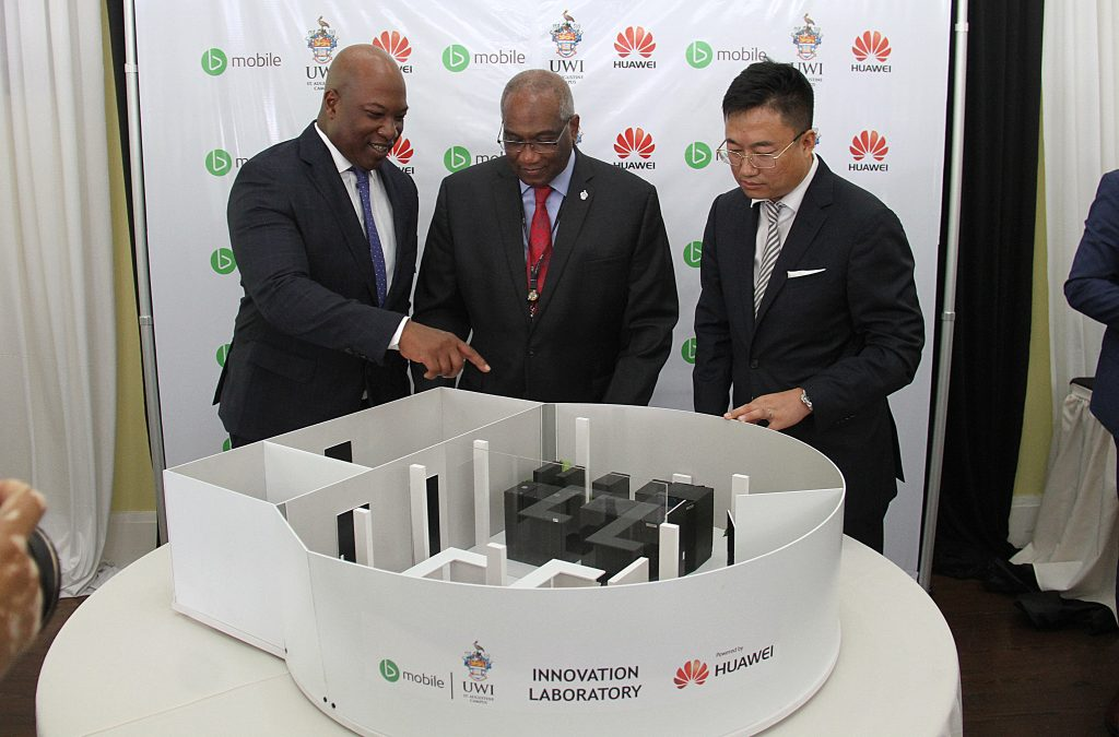 UWI 1:  TSTT CEO Dr Ronald Walcott, left to right, UWI Pro Vice-Chancellor Professor Brian Copeland and CEO of Huawei TT Jeff Jin inspect a model of an innovation lab at the Office of the Campus Principal, UWI, St. Augustine on Thursday. PHOTOS BY AYANNA KINSALE