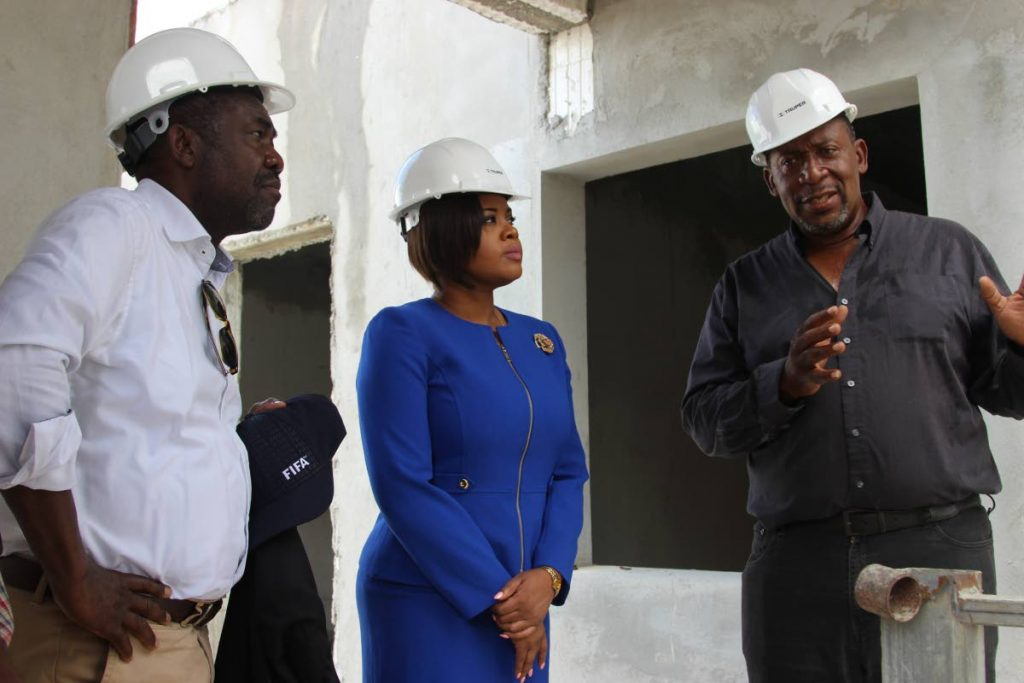 In this August 19 2018 file photo ,TTFA president David John-Williams, right, discusses the progress at the Home of Football site, in Balmain, Couva with Sport and Youth Affairs Minister Shamfa Cudjoe, centre, and FIFA director of Member Associations and Development for the Caribbean and Africa. PHOTO COURTESY THE MINISTRY OF SPORT AND YOUTH AFFAIRS