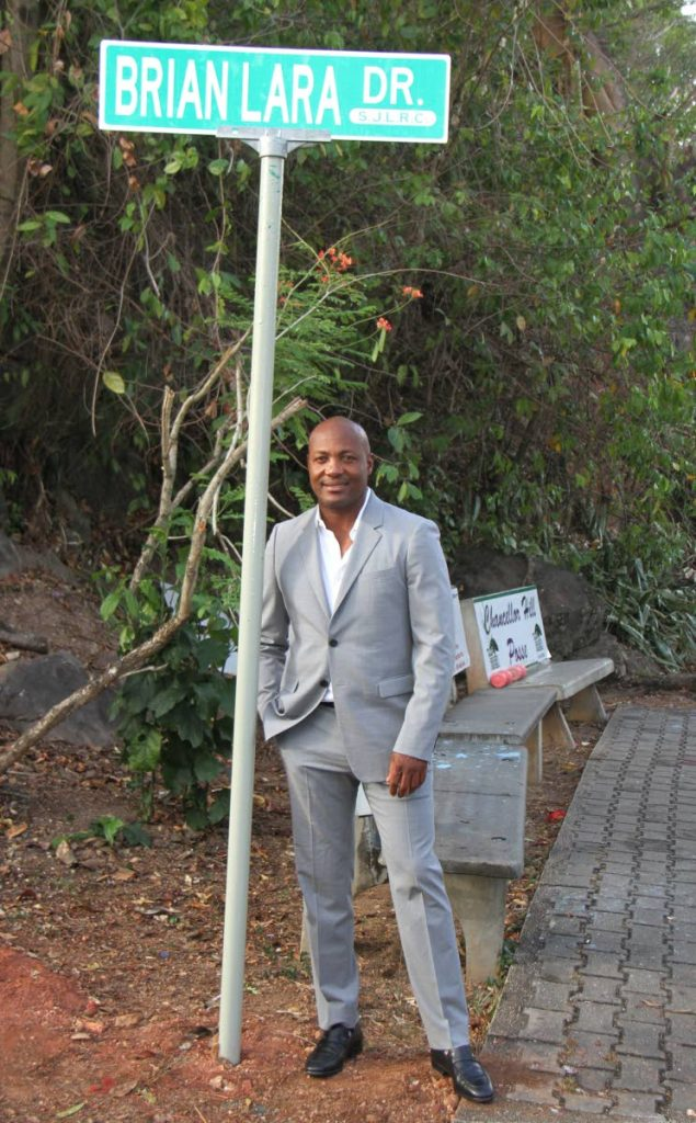 Cricket legend Brian Lara stands next to his own street sign at Chancellor Hill, Port of Spain on May 2. PHOTO BY ANGELO MARCELLE