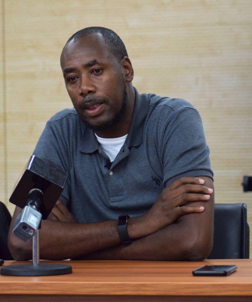 TT men's head coach Dennis Lawrence.