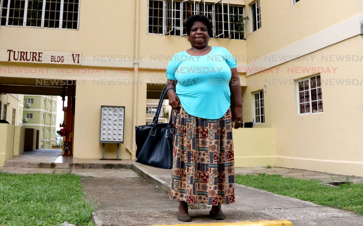 Zeia Flemming stands in front of her appartment building at Olera Heights, San Fernando. FILE PHOTO