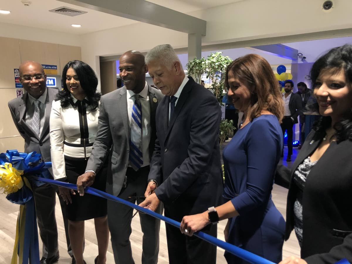 In this August 2019 file photo, Port of Spain Mayor Joel Martinez (third from right) cuts the ribbon to open RBC TT's new digitally-enabled branch in Maraval, along with (from left) Central Bank's Patrick Solomon, RBC Maraval branch manager Jenelle Alexander-Ramkissoon, RBC Financial CEO Darryl White and RBC TT managing director Gretchen Camacho-Mohammed.