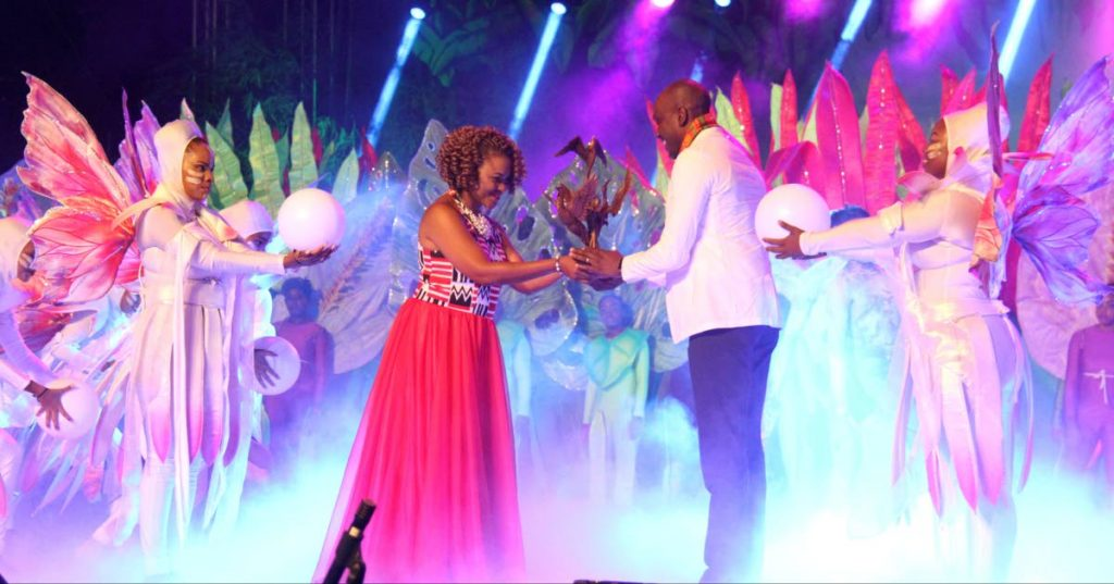 Minister of Culture Nyan Gasby Dolly hands over the Carifesta baton to Antigua and Barbuda's Daryll Matthew, Minister of Sports Culture and Arts at the closing ceremony of Carifesta at the Queen's Park Savannah, Port of Spain.