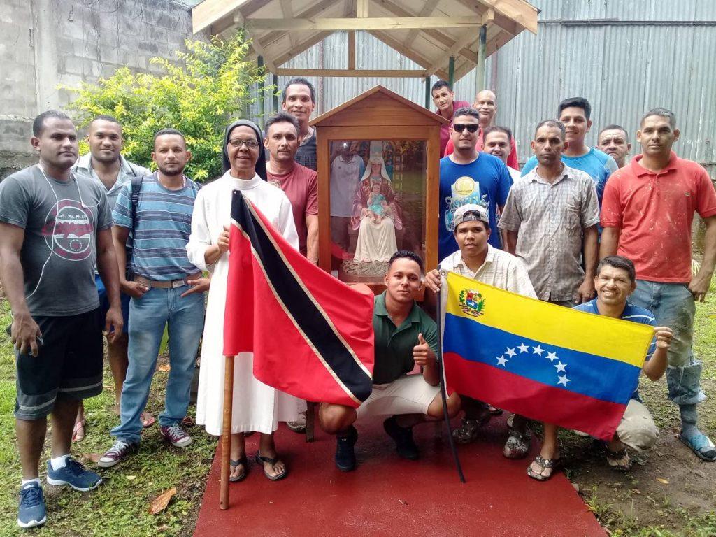 Venezuelan workers with Sr Ann Bradshaw and the image of Our Lady of Coromoto, patron saint of Venezuela. PHOTOS BY GREVIC ALVARADO