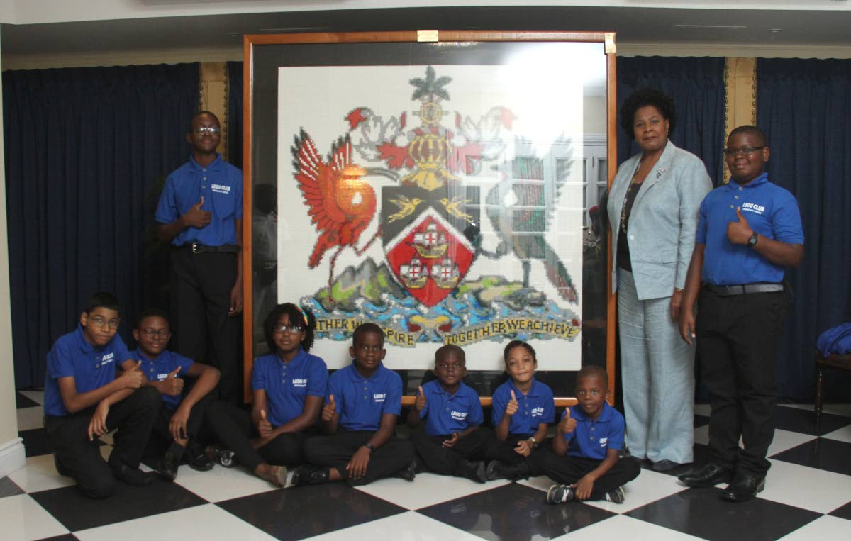 President Paula-Mae Weekes with members of the Lego Club of TT who presented her with a replica of the coat of arms at the Office of the President, St Ann's on August 29. FILE PHOTO/AYANNA KINSALE