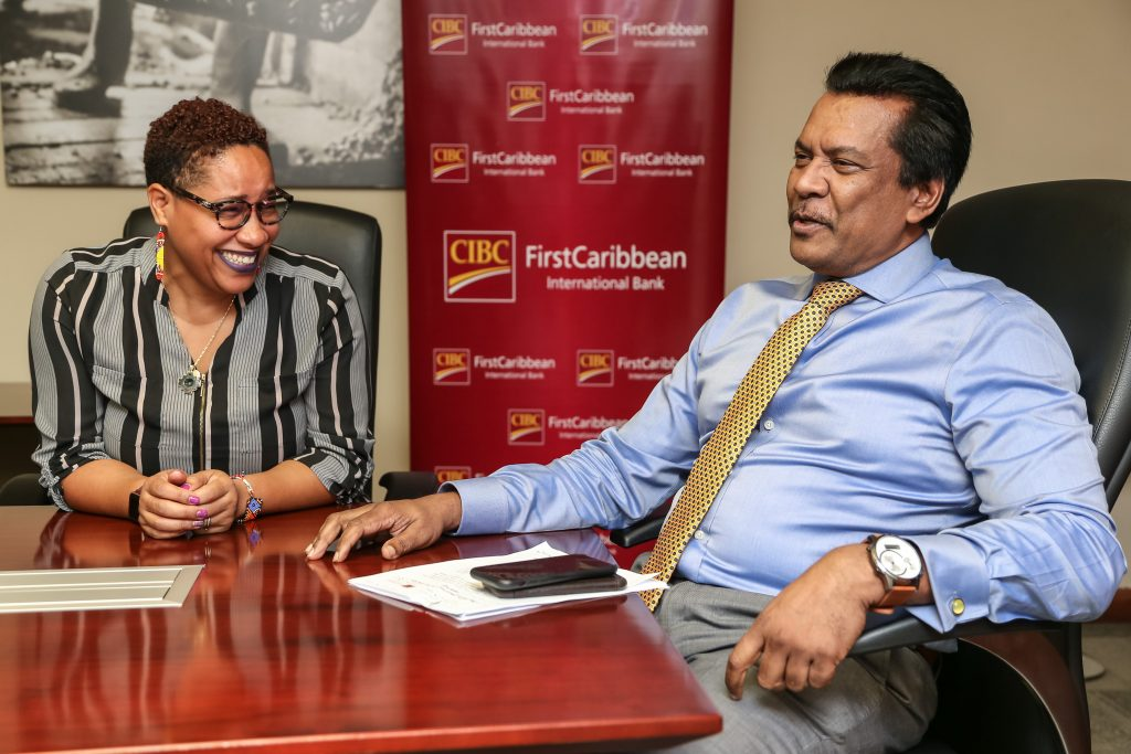 Dr Asante Le Blanc, first vice-chairman of the Cancer Society, chats with CIBC managing director Anthony Seeraj at the CIBC's office at Long Circular Road, Maraval. Photo by Jeff Mayers