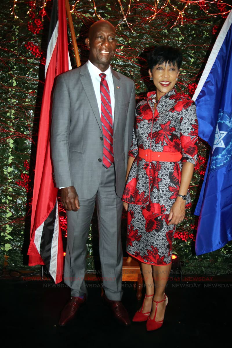 Together forever: Prime Minister Dr Keith Rowley and his wife Sharon during Independence Day celebrations at Police Administration Building, Port of Spain yesterday. PHOTO BY SUREASH CHOLAI