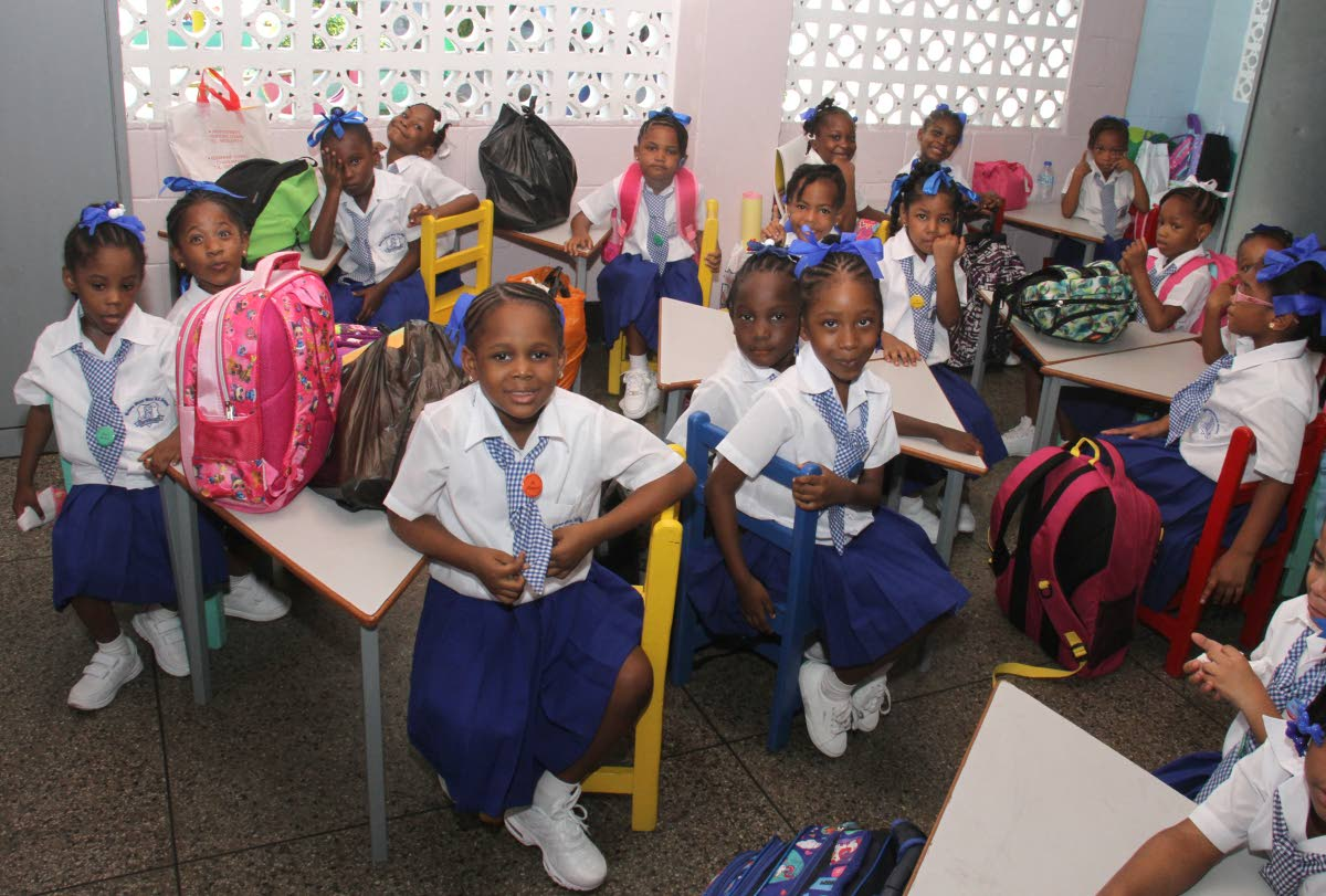 Nelson Street Girls' RC School students settle in for class on the first day of school last Monday.  PHOTO BY AYANNA KINSALE