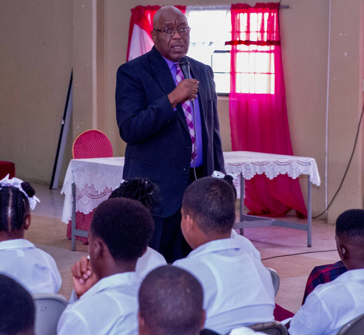 Chief Secretary Kelvin Charles praises students of Pentecostal Light and Life Secondary for raising the school's CXC pass mark from 24 per cent to 75 per cent.