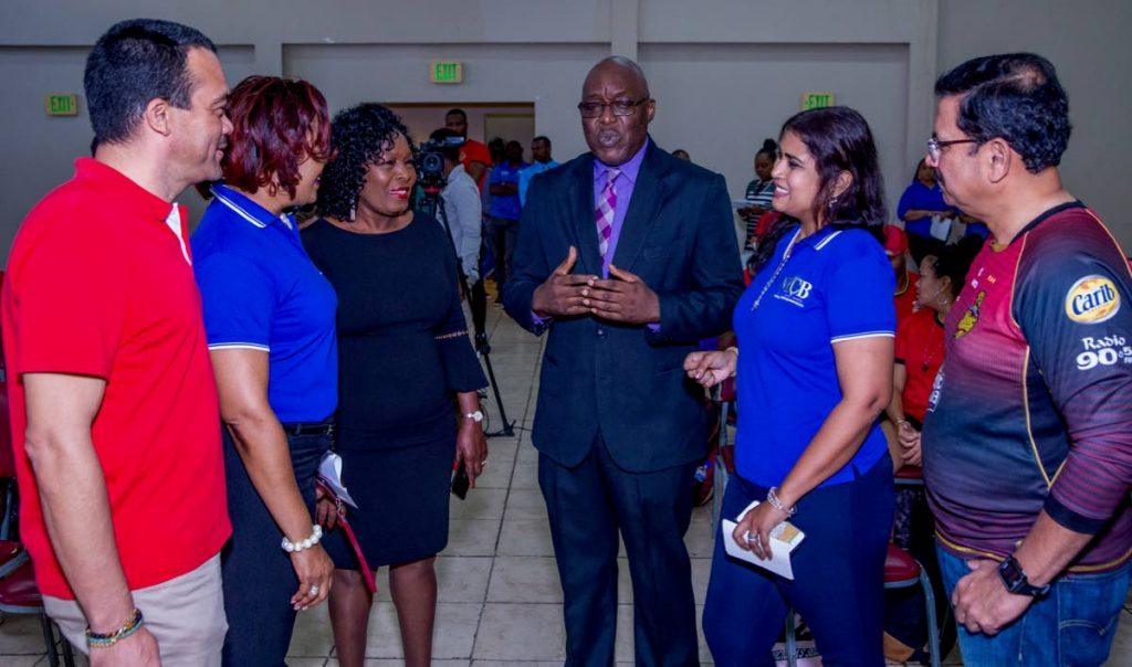 Chief Secretary Kelvin Charles, centre right, and Community Development Secretary Marslyn Melville-Jack, centre left, chat with Trinbago Knight Riders CEO Venky Mysore, right, representatives from NLCB and other officials at a meet and greet session on Monday, at the Lowlands Multi-Purpose Facility.