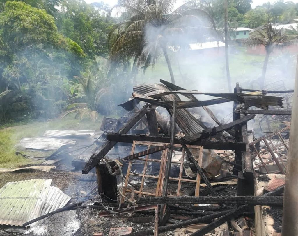 The remains of Kavita Boodoo's home at Oilfield Road, Union Village, after it was destroyed by fire on Tuesday. PHOTO COURTESY MINISTRY OF RURAL DEVELOPMENT AND LOCAL GOVERNMENT