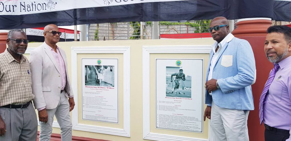 Olympic gold medalist Hasely Crawford, 2nd from right, at the unveiling of two commemorative plaques, in his and other Olympian Rodney Wilkes' honour last Wednesday. Second from left is San Fernando Mayor Junia Regrello. PHOTO BY YVONNE WEBB