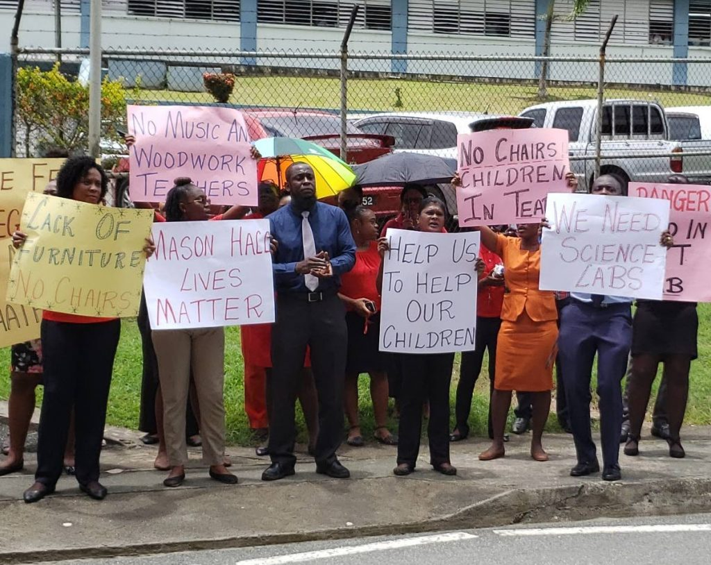 Mason Hall Secondary School teachers protest outside the school compound yesterday.