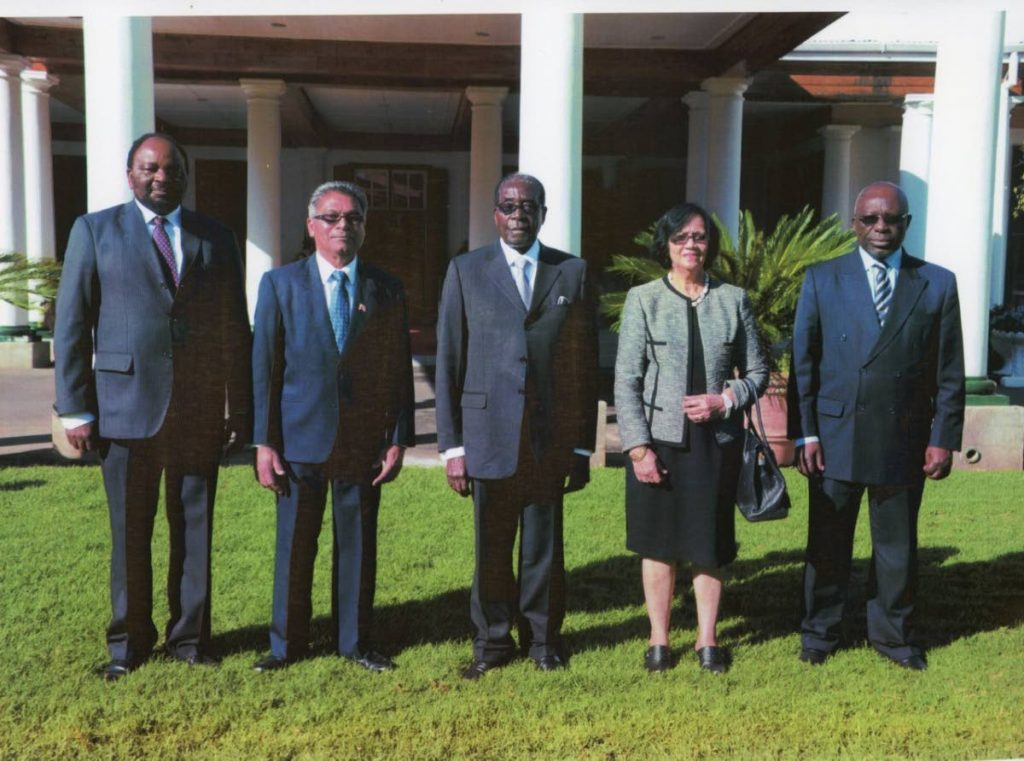 Former High Commissioner to South Africa Harry Partap with late Zimbabwe president Robert Mugabe (at right). Next to him is Partap's wife Nazra, in front of Zimbabe's State House