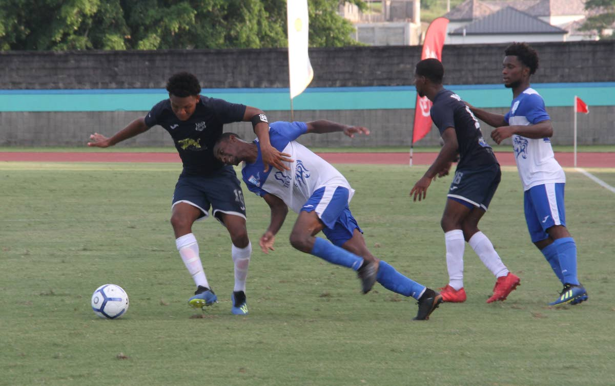 Decklan Marcelle (left) of Naparima tries to get past his Presentation San Fernando opponent during yesterday's game at the Manny Ramjohn Stadium, Marabella. PHOTO BY VASHTI SINGH.