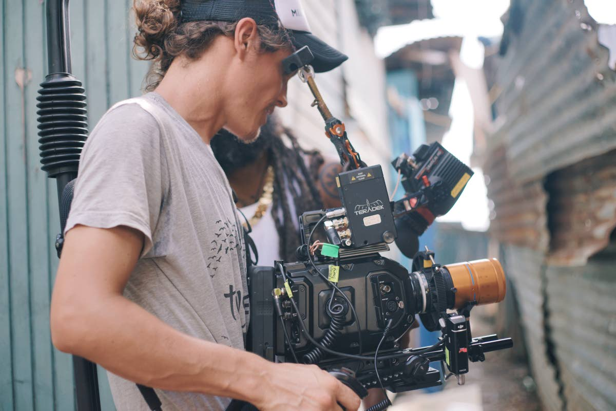 Director Oliver Milne shooting Freetown's Collective's music video on George Street, Port of Spain.
