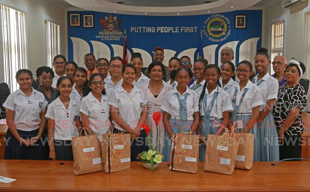 Principal of Success Laventille Secondary School Hamida Baksh, centre, with Naparima High School Dance Students, left, and St Joseph's Convent Choir members at the San Fernando City Hall on Monday. PHOTO BY MARVIN HAMILTON