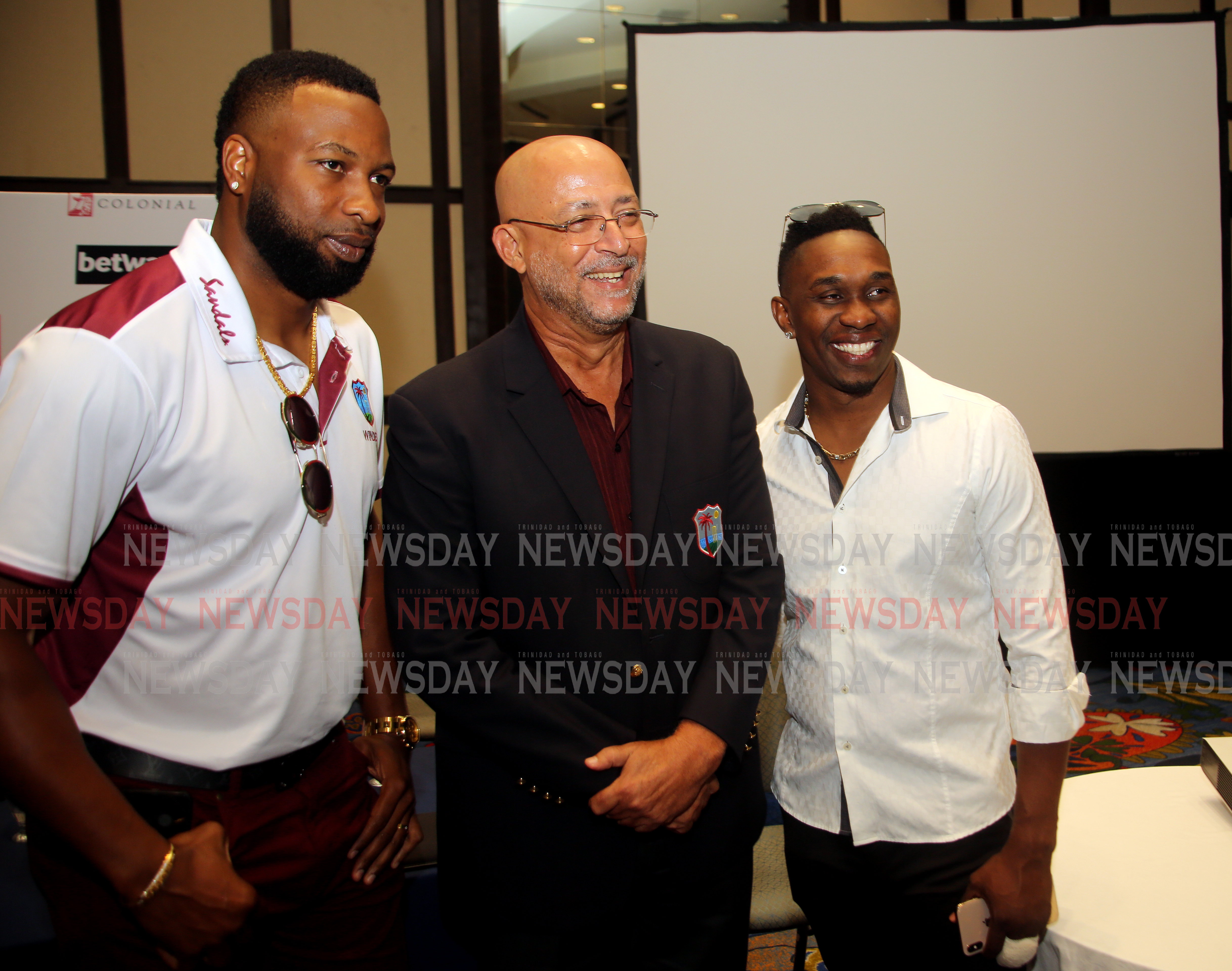 Kieron Pollard (from left)  Ricky Skerritt,  President of Cricket West Indies and  Dwayne Bravo,  during at press conference at Hilton Trinidad in which Pollard was name captain of the West Indies' one-day international and T20 teams .   PHOTO SUREASH CHOLAI