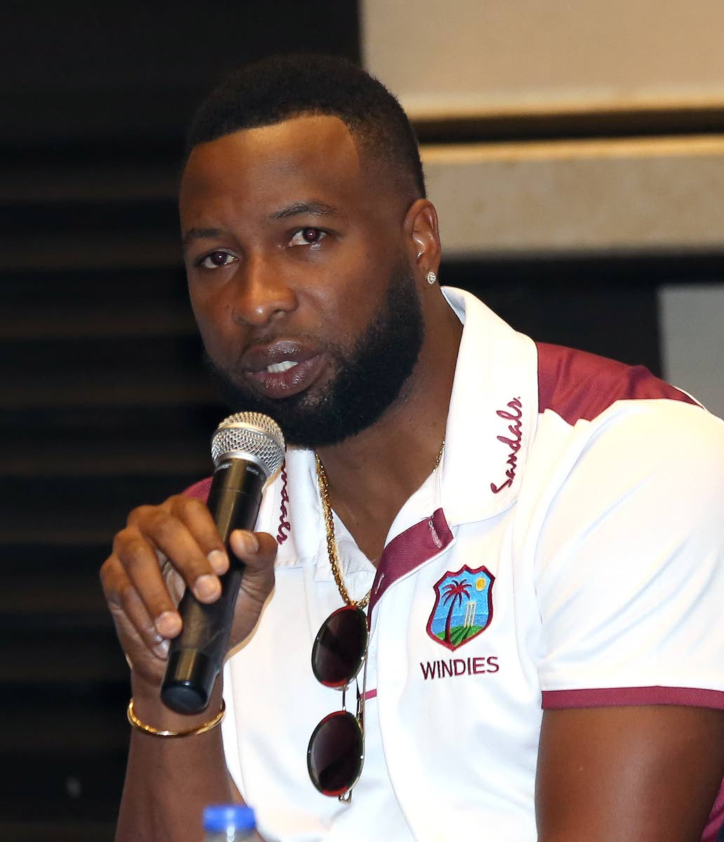 West Indies captain Kieron Pollard  addresses the media yesterday, during a Cricket West Indies press conference, at the Hilton Trinidad.