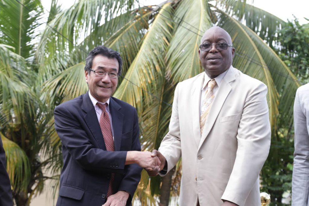 Chief Secretary Kelvin Charles, right, shakes the hand of Japan Ambassador to TT Tatsuo Hirayama at the sod turning ceremony for a disaster response centre in Speyside.
