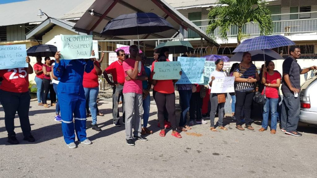 Members of the PTA protest outside the dilapidated Fyzabad Anglican secondary school.