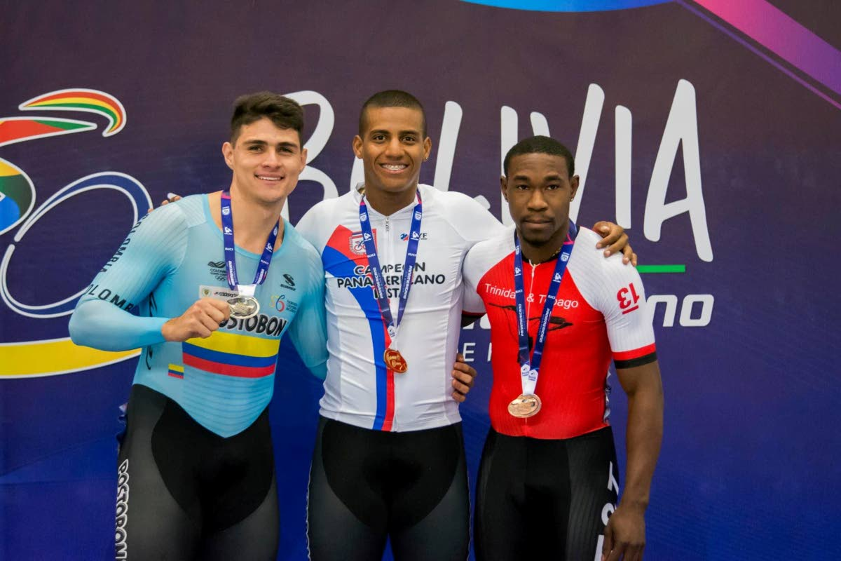 TT's Keron Bramble, right,displays his first-ever individual Men's Keirin bronze medal at the Pan American Championships.