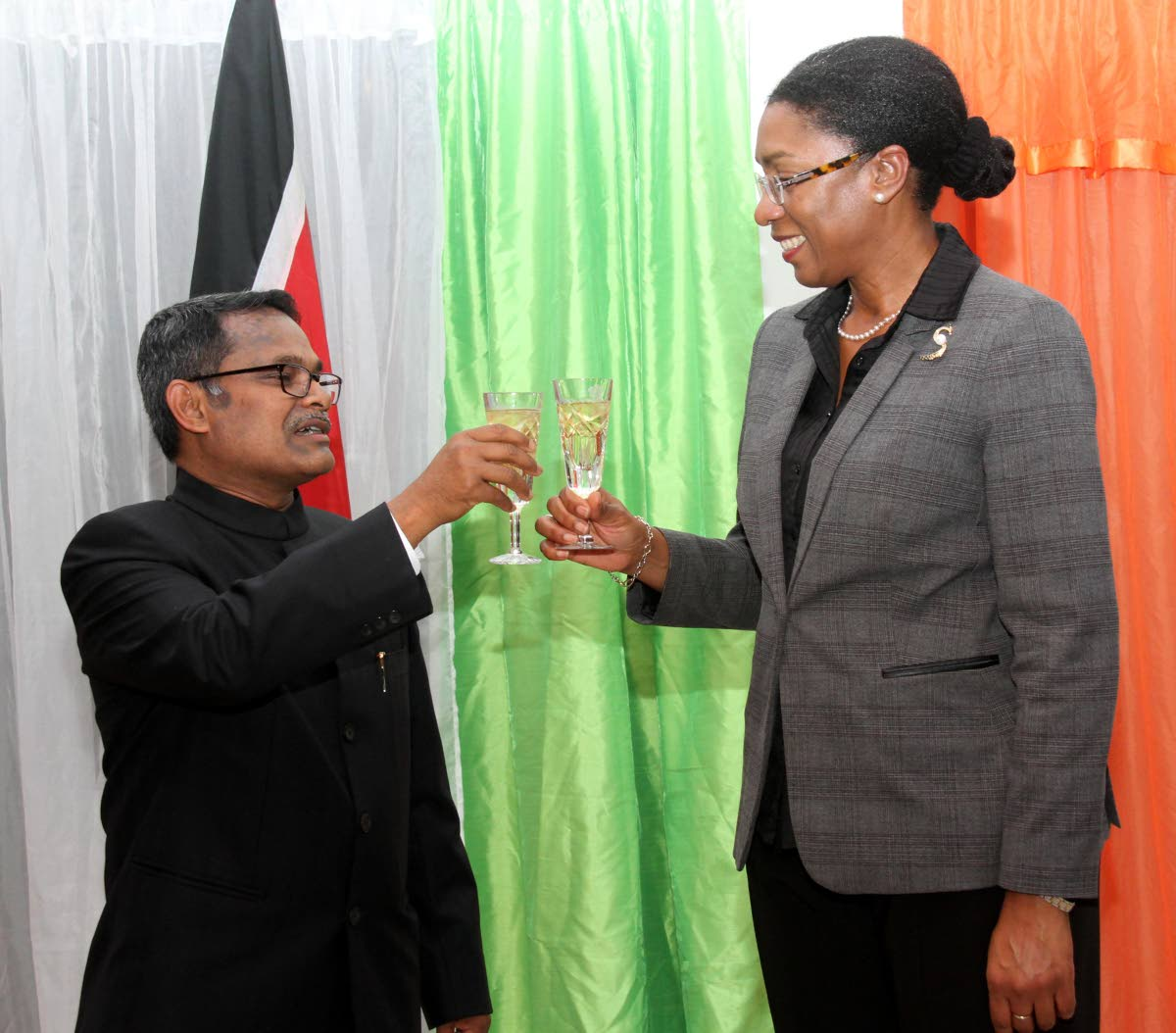 Newly appointed Indian High Commissioner to TT Arun Kumar Sahu, left,  and Foreign and Caricom Affairs permanent secretary Reita Toussaint share a toast.