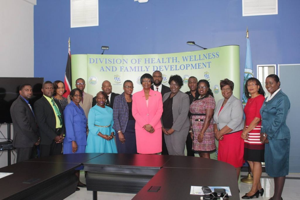 Members of both FRC Committees pose for a photo with Councillor Dr. Agatha Carrington, Secretary of Health, Wellness and Family Development (centre front row) and Mrs. Dianne Baker-Henry, Administrator, DHWFD (5th from left, front row).
