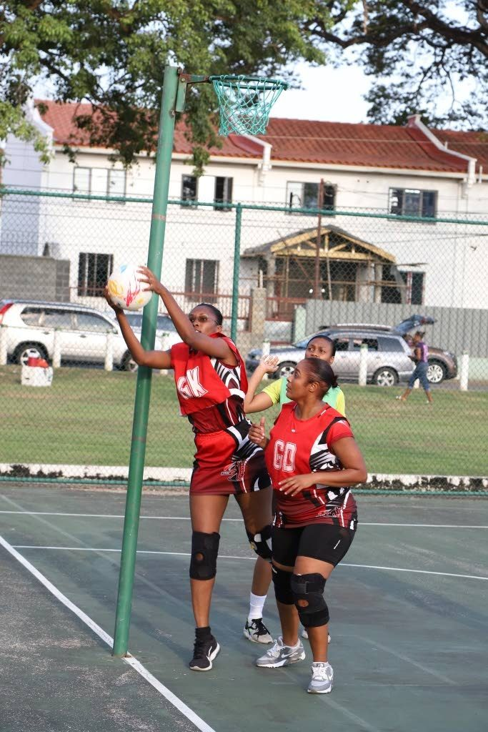 TTPOST Warriors' Goal Keeper retrieves the ball from the goal post at the opening of the Republic Bank Laventille Netball League, last Saturday, at Nelson Mandela Park.
