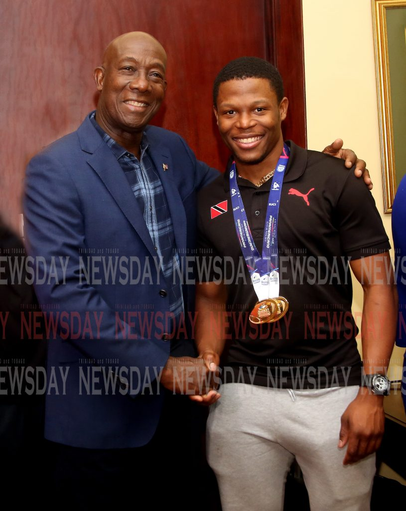 "TEAM TTO's top sprint cyclist and world record holder Nicholas ""Nico"" Paul  and teammate  Keron Bramble and rest of team return home Tuesday night, from Bolivia ,they were met at the VIP Lounge of the Piarco International Airport  by Prime Minister Dr Keith Rowley and Sports Minister Shamfa Cudjoe, PHOTO SUREASH CHOLAI"