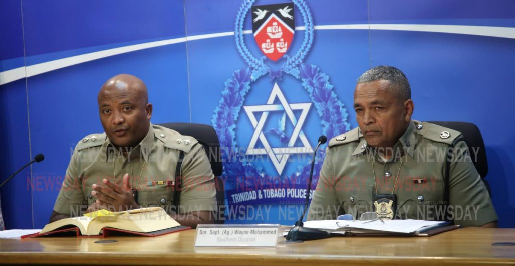File photo:   From left: Supt (Ag) Wayne Mystar, left, and Snr Supt (Ag) Wayne Mohammed at a press briefing at the Police Administration Building in Port of Spain.  PHOTO  SUREASH CHOLAI