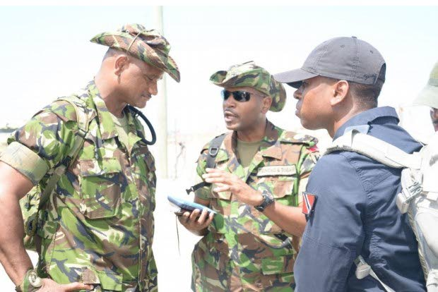 TTDF Task Force Commander, Major Derron Mc Lean, centre,  brief members of his team on operations on the ground in Grand Bahama, Bahamas on Tuesday.