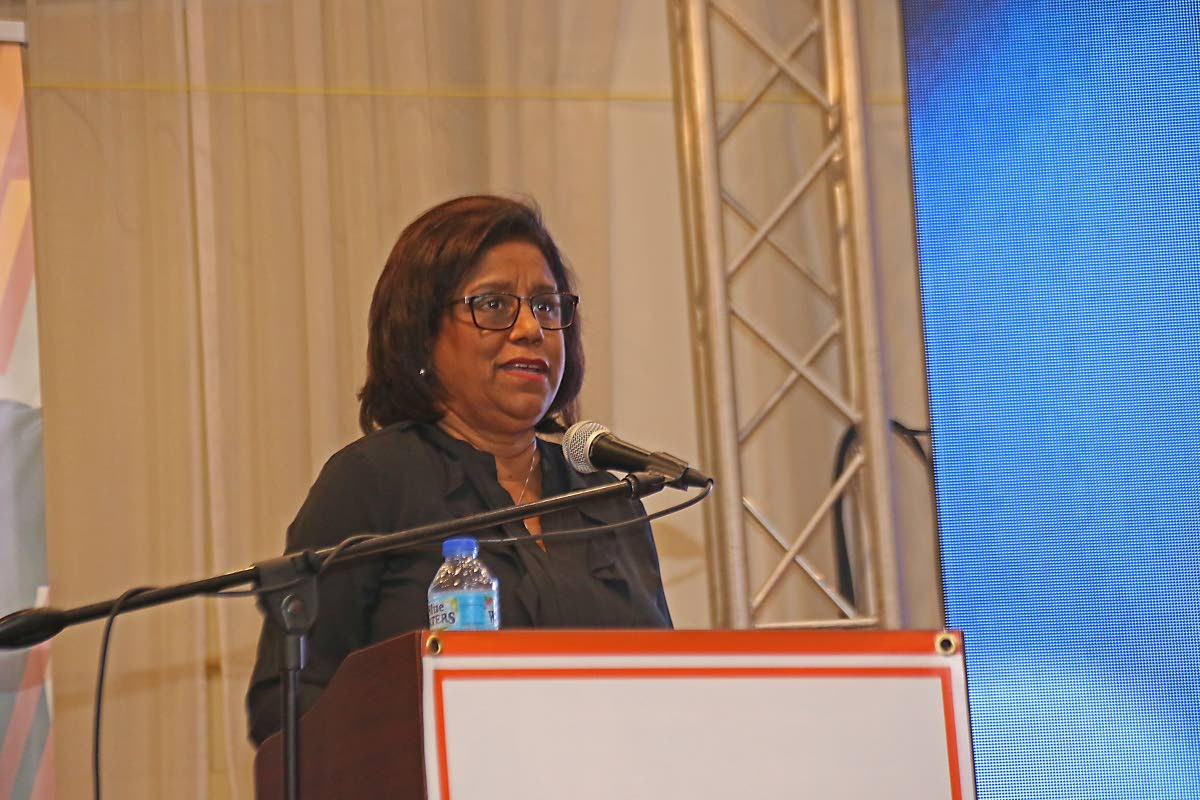 Trade and Industry Minister Paula Gopee-Scoon speaks on Tuesday at the launch of the Full Gospel Businessmen's trade website at the Passage to Asia Restaurant in Chaguanas.