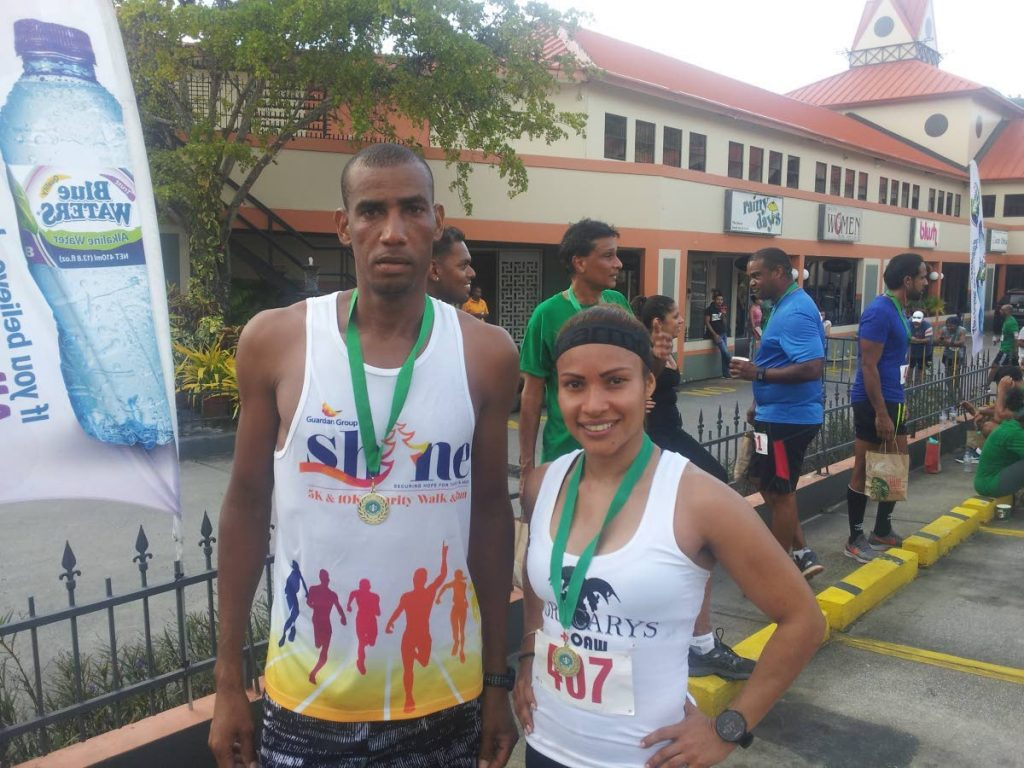 Winners of the 2018 Starbucks 5K event Lionel Dandrade, left, and Thais Gutierrez. The pair will not compete this year making room for new champions.