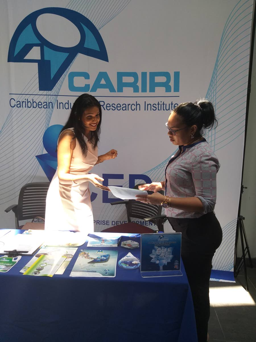 BUSINESS TALK: Officials from CARIRI were at the exporTT's seminar on innovation on Wednesday at the Arthur Lok Jack Graduate School of Business in Champs Fleurs.  PHOTO BY TYRELL GITTENS
