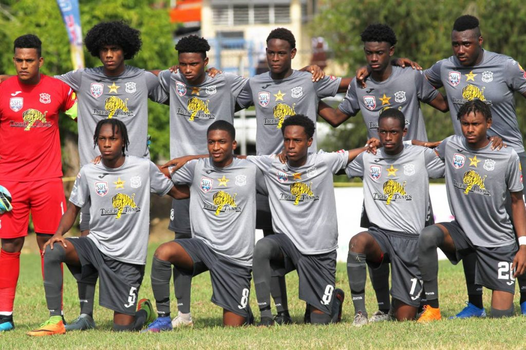 Naparima College's footballers pose for team photo prior to the start of their opening match against St Mary's, in the Secondary Schools Football League, on Wednesday.