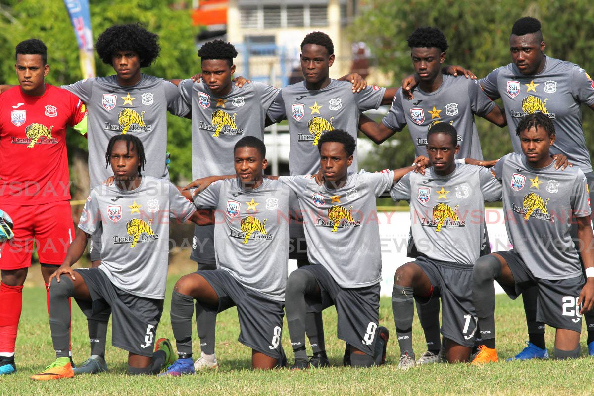 Members of the Naparima football team ahead of last Wednesday's match against St Mary's, at Lewis Street, San Fernando. PHOTO BY LINCOLN HOLDER