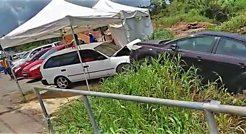 A still frame taken from video posted to social media showing a woman using her car, left, to ram another car into a ravine.