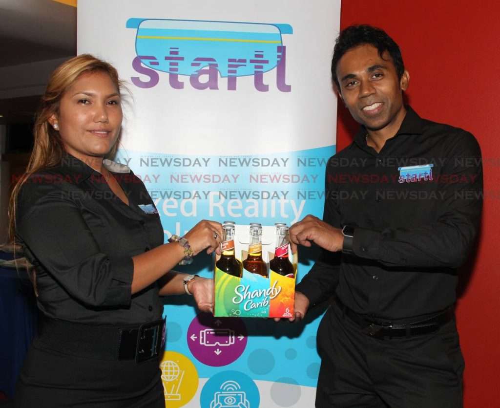 Jeanette Motilal-Boodoo and Keith Laban, of Startl Augmented Reality Solutions the Carib Brewery Limited screening and launch of Shandy Carib brand and augmented reality series powered by the Startl App, Queen's Hall, St Anns.   PHOTO BY ROGER JACOB.